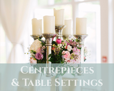 wedding centerpieces and gold cutlery hire