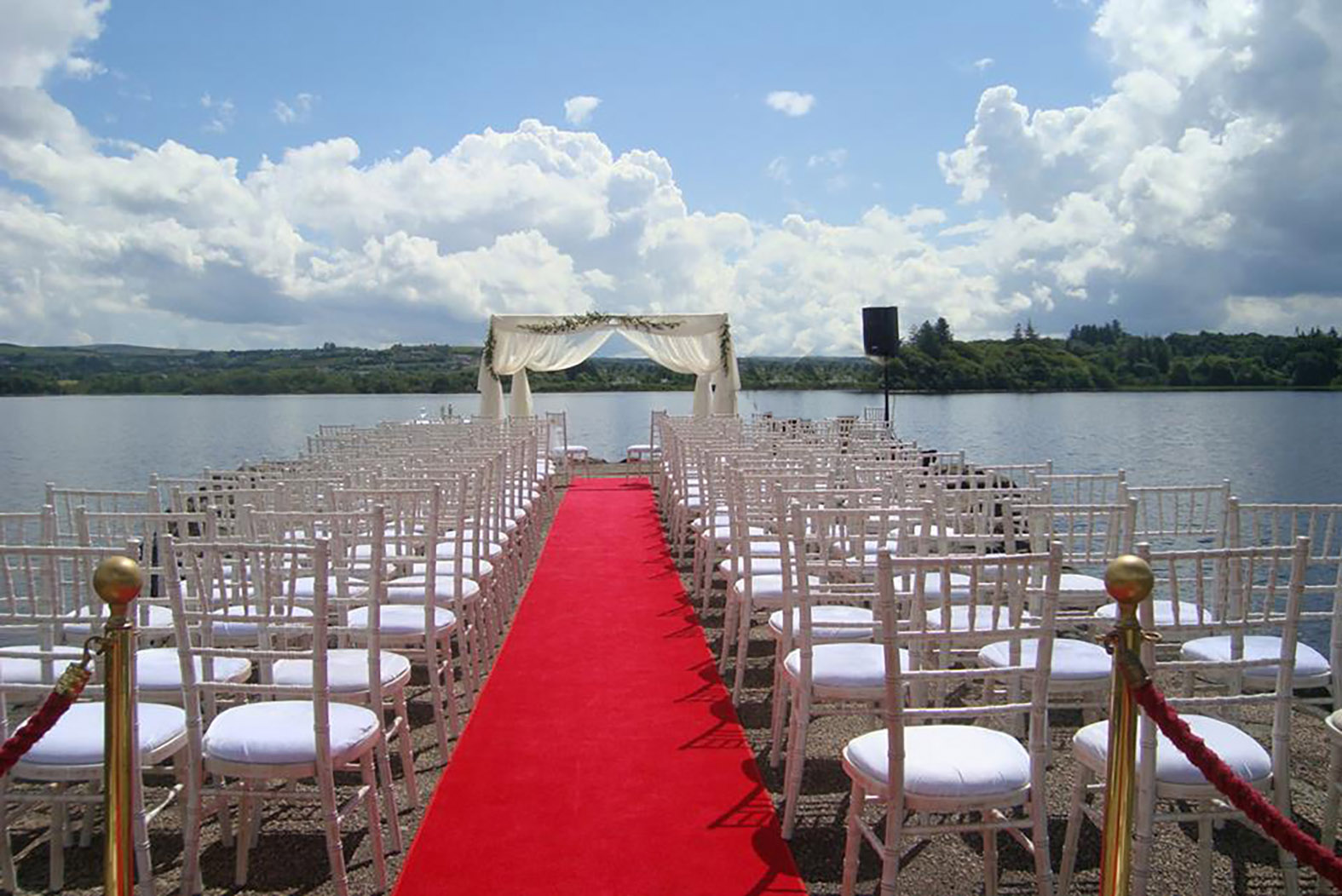 outdoor wedding ceremony by the water